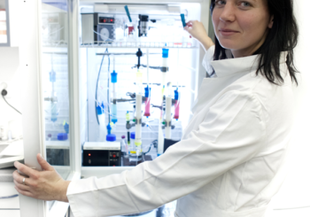 Scientist cleaning protein purification system